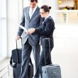 Stock Photo: Businessman and businesswoman at airport