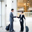 Business travellers meeting at airport — Stock Photo