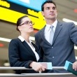 Determined business travellers in airport — Stock Photo