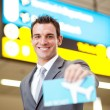 Happy businessman presenting air ticket — Stock Photo