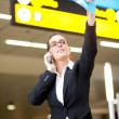 Stock Photo: Businesswoman waving to someone at airport