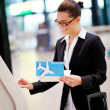 Businesswoman using self help check in machine at airport — Stock Photo #10422756