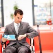 Businessman waiting at airport - Stockfoto