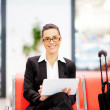Businesswoman using tablet at airport — Stock Photo #10422807