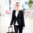 Young businesswoman walking in airport — Stock Photo #10422813