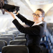Businesswoman on airplane — Stok fotoğraf