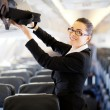 Businesswoman on airplane — Stockfoto