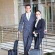 Business travellers at airport — Stock Photo #10422851