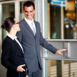 Businessman and businesswoman using elevator at airport — Stock Photo #10422853