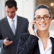 Beautiful young businesswoman on cell phone — Stock Photo #10422870