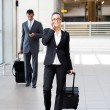 Businesspeople walking in airport — Stock Photo #10422873
