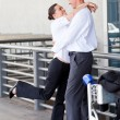 Royalty-Free Stock Photo: Happy couple hugging at airport
