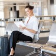 Businesswoman using tablet computer at airport — Stock Photo