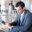 Businessman waiting for flight - Stock Photo