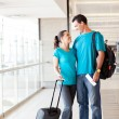 Young couple at airport — Stock Photo #10422929