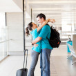 Happy couple reunion at airport — Stock Photo #10422932