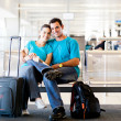 Royalty-Free Stock Photo: Young couple waiting for flight