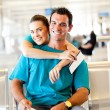 Happy couple at airport — Stock Photo #10422949