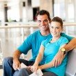 Casual young couple at airport — Stock Photo