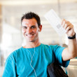 Young man at airport — Stock Photo