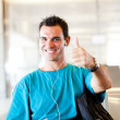 Young traveller giving thumb up — Stock Photo