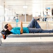 Young man resting at airport - Stock Photo