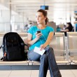 Young woman waiting for her flight — Stock Photo