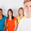 Young man in front of group of — Stock Photo