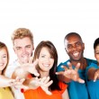 Group of multiracial friends reaching for the camera — Stock Photo