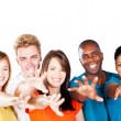 Group of multiracial friends reaching for the camera - Stock Photo