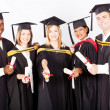 Group of multicultural university graduates — Stock Photo