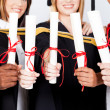 Stock Photo: Group of graduates holding certificates