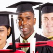 Multiracial university students graduation — Stock Photo