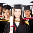 Foto de Stock  : Group of graduates in graduation gown and cap