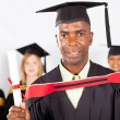 Male african graduate at graduation — Stock Photo