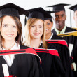 Group of multiracial graduates — Stock Photo