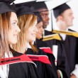 Group of graduates at graduation — Stock Photo