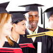 Group of diverse graduates at graduation - Stock Photo