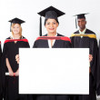 Female indian graduate with white board — Stock Photo