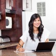 Indian woman doing home finance — Stock Photo