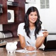 Beautiful indian woman paying credit card bills — Stock Photo