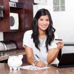 Beautiful indian woman paying credit card bills — Stock Photo