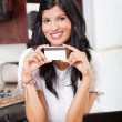 Royalty-Free Stock Photo: Beautiful indian woman holding credit card