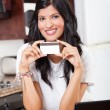 Beautiful indian woman holding credit card — Stock Photo