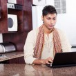 Young indian man using laptop — Stock Photo