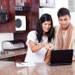 Young indian couple using computer - Foto de Stock