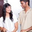 Happy indian couple cooking — Stock Photo