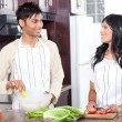 Young indian couple in kitchen — Stock Photo