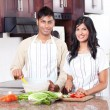Royalty-Free Stock Photo: Young indian couple cooking
