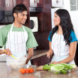 Stock Photo: Modern indian couple cooking in kitchen